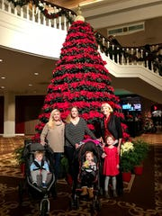 The Poinsettia tree in the Magnolia Lobby sets the tone for a fun festive outing to the Gaylord Opryland Resort and Convention Center .