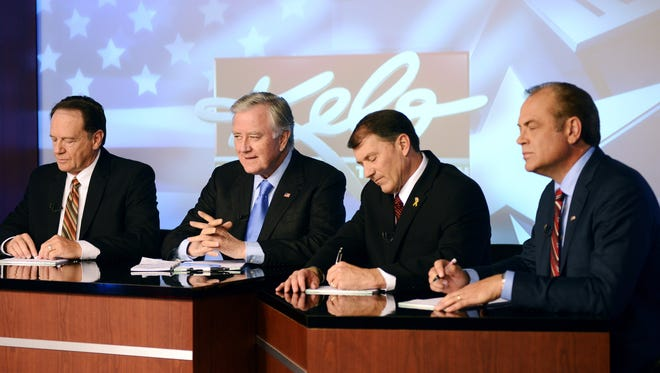 From left, independant U.S. Senate candidate, Gordon Howie; independant U.S. Senate candidate, Larry Pressler; Republican U.S. Senate candidate, Mike Rounds; and Democratic U.S. Senate candidate, Rick Weiland prepare for a televised U.S. Senate debate on Keloland T.V. Wednesday, Oct. 29, 2014, at the Keloland T.V. Studios in downtown Sioux Falls, S.D.
