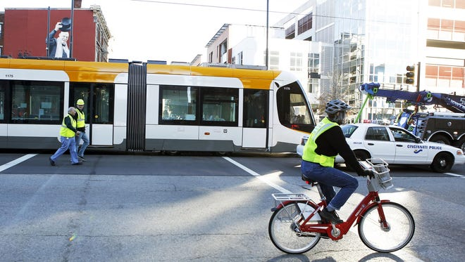 During tests in November, Mary Messman of Madisonville rode a Cincy Red Bike as she followed the streetcar while it was being towed.