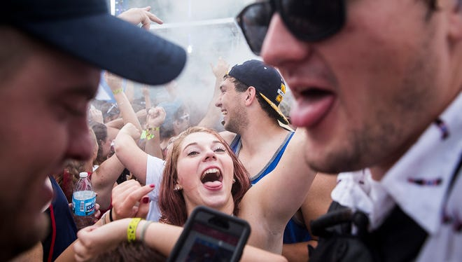 Thousands of attendees dance and drink in the Snake Pit at the Indianapolis Motor Speedway Sunday, May 28, 2017.