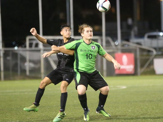 In this file photo, the Bank of Guam Strykers FC's Scott Spindel and Haya United's Giancarlo Abril fight for possession of the ball during a Week 10 match of the Budweiser Soccer League Premier Division.