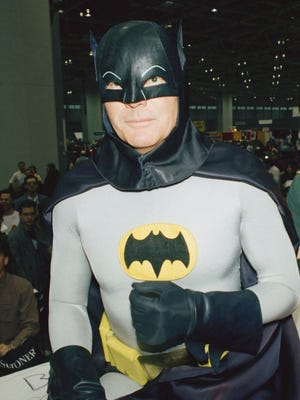 Adam West dressed as Batman posed for a photo at the 'World of Wheels' custom car show in Chicago on Jan. 27, 1989.