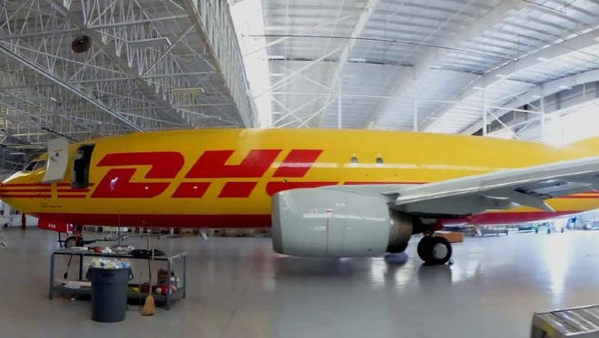 DHL plans to add 100 new jobs at its CVG-based North American hub over the next decade.