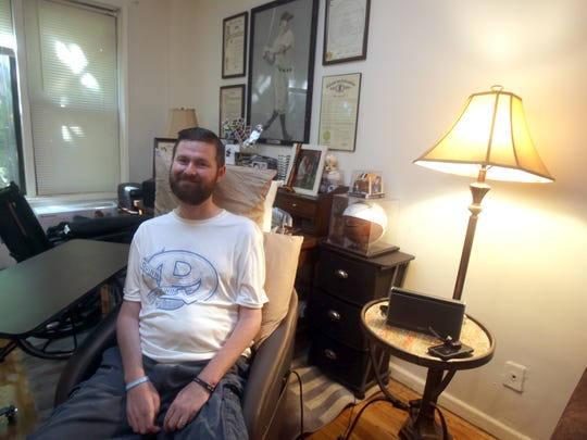 Pat Quinn, 33,  of Yonkers was one of the key people to make the Ice Bucket Challenge go viral two years ago. Quinn, photographed at home Aug. 5, 2016, was diagnosed with ALS, also known as Lou Gehrig's disease, in 2013.  A photo of Gehrig hangs behind him in his apartment.
