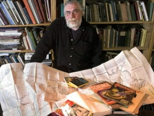 Jim Lewin, owner of The York Emporium, poses in 2008 with some of the rare books and other items he planned to sell at the York Book and Paper Fair that fall. (File photo)
