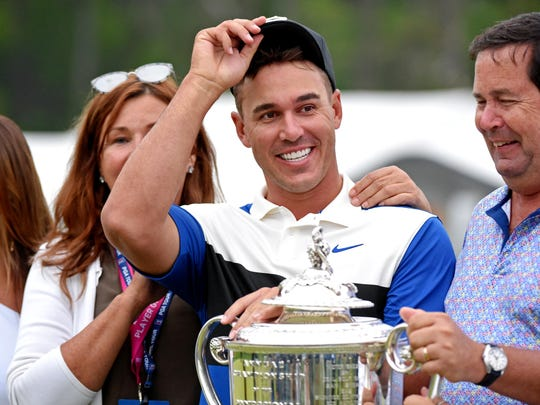 May 19, 2019; Bethpage, NY, USA; Brooks Koepka celebrates with his family after winning the PGA Championship golf tournament at Bethpage State Park - Black Course. Mandatory Credit:
