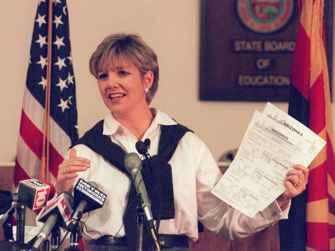 Lisa Graham Keegan addresses the media during a press