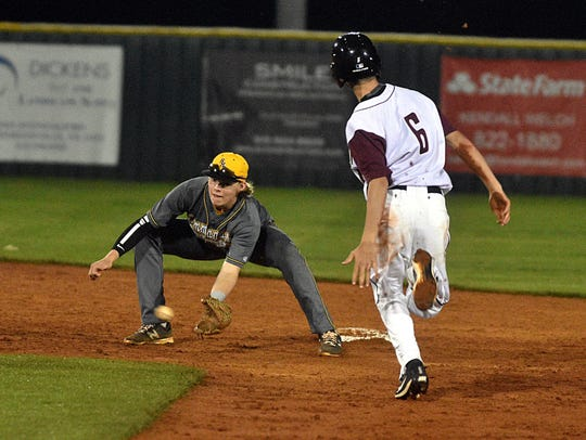 Hendersonville junior shortstop Brett Coker fields