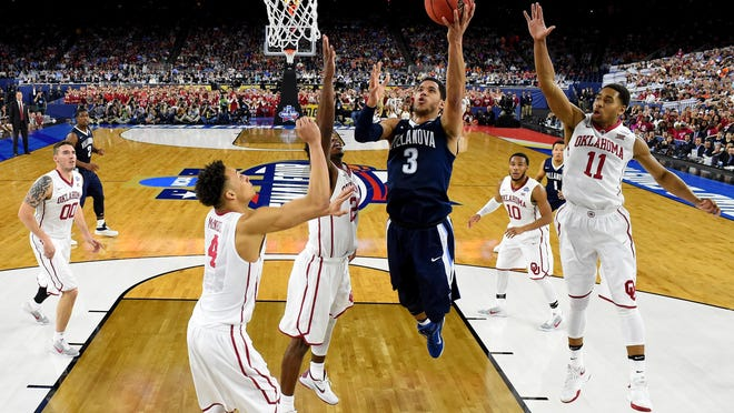 HOUSTON, TEXAS - APRIL 02: Josh Hart #3 of the Villanova Wildcats drives to the basket against Jamuni McNeace #4 of the Oklahoma Sooners, Buddy Hield #24, and Isaiah Cousins #11 in the second half during the NCAA Men's Final Four Semifinal at NRG Stadium on April 2, 2016 in Houston, Texas. (Photo by Robert Deutsch - Pool/Getty Images)