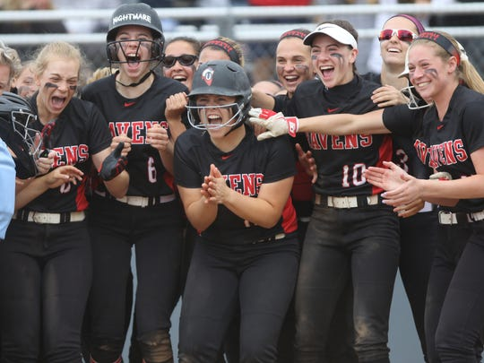 Robbinsville waits for their teammate, Kate Hunter (not shown) at home plate after she hit a three-run home-run. Sunday, June 3, 2018
