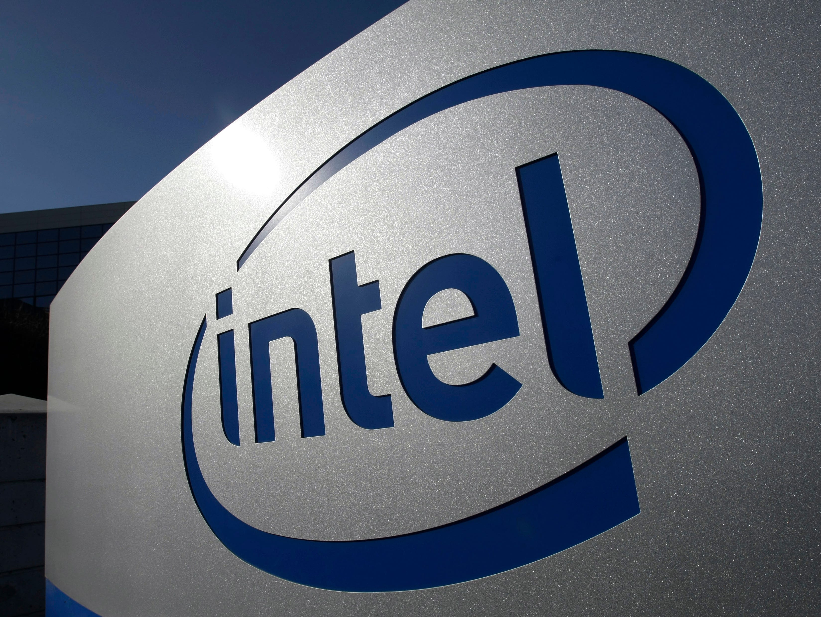 In this Jan. 12, 2011, file photo, the Intel logo is displayed on the exterior of Intel headquarters in Santa Clara, Calif.