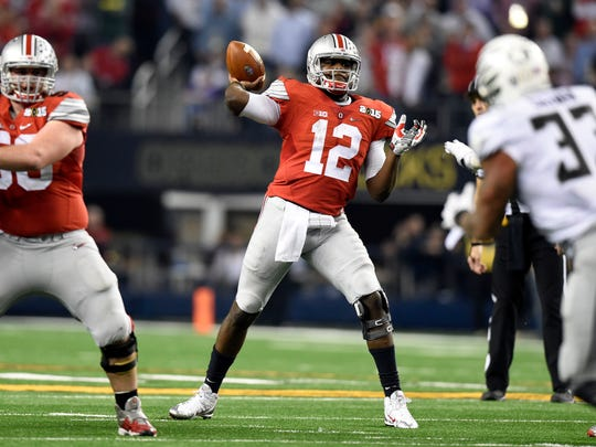 Ohio State Buckeyes quarterback Cardale Jones (12) throws a pass during the fourth quarter against the Oregon Ducks in the 2015 CFP National Championship Game on Monday at AT&T Stadium in Arlington, Texas.
