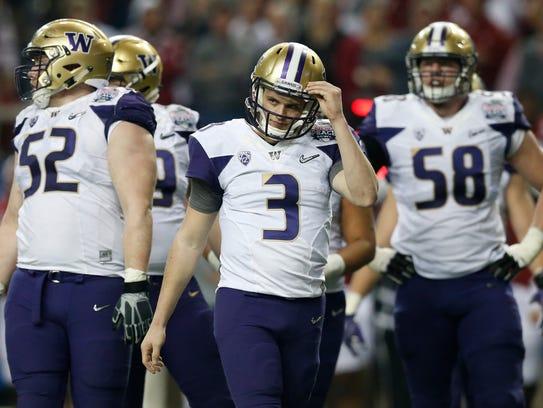 Washington Huskies quarterback Jake Browning (3) reacts