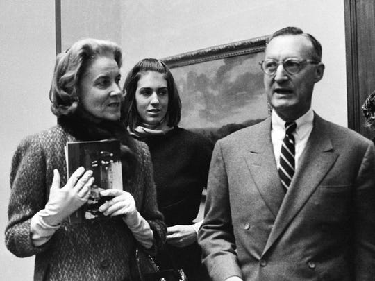 Paul Mellon, right, wife Rachel Bunny Mellon, left, and stepdaughter Eliza Lloyd attend a preview of the Mellons' collection of English art at the Royal Academy in London in 1964.
