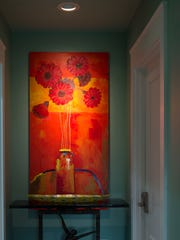 """Poppies"" by Gunnar Erman hangs in the vestibule that connects the master bedroom with the master bath (to the left) and closet (to the right)."