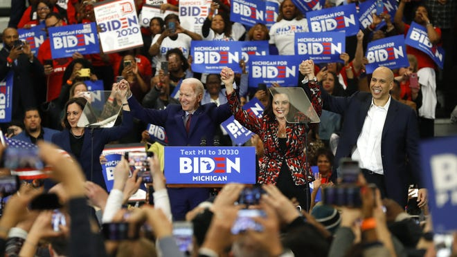 """FILE - In this March 9, 2020, file photo, Sen. Kamala Harris, D-Calif., from left, Democratic presidential candidate former Vice President Joe Biden, Michigan Gov. Gretchen Whitmer, and Sen. Cory Booker D-N.J. greet the crowd during a campaign rally in Detroit. Whitmer's quick ascension to the national stage â€"""" and on Biden's list of potential running mates â€"""" has left Democrats both thankful she will continue to lead Michigan after he chose Kamala Harris but also excited about what the governor's future may hold."""