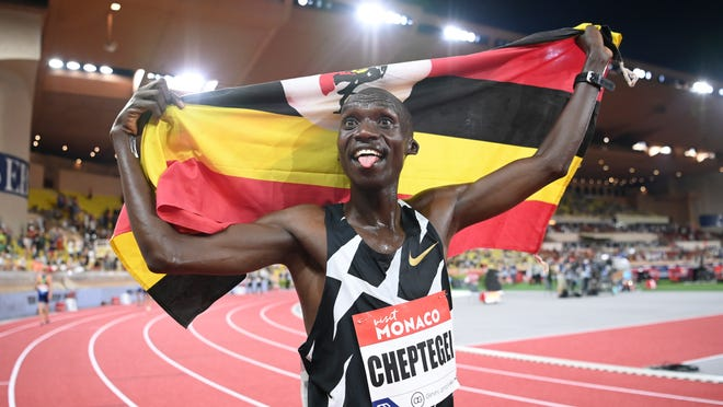 Uganda's Joshua Cheptegei sticks his tongue out after breaking the wold record in the men's 5000 meter final during the Diamond League athletics meeting in Monaco Friday, Aug. 14, 2020.