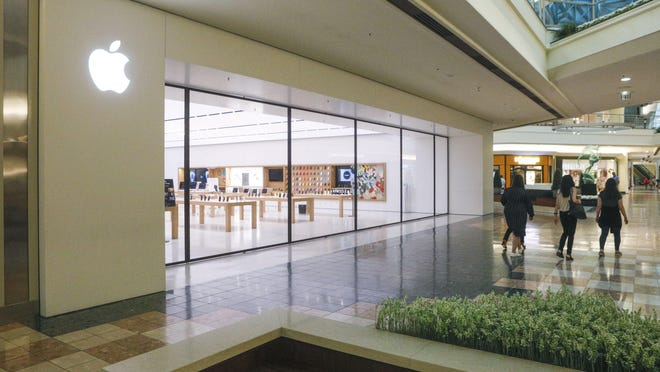 The Apple Store inside The Gardens Mall is one of 32 that have been closed temporarily amid a spike in coronavirus cases.