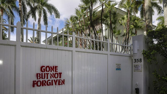 """Someone spray-painted the words """"GONE BUT NOT FORGIVEN"""" on the gate of the former residence of the late convicted sex offender Jeffrey Epstein."""