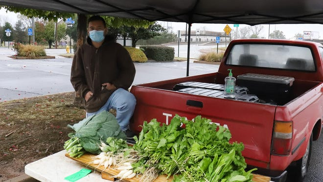 Cordell Carr sells fresh seasonal vegetables, Tuesday, Oct. 27, at the Downtown Farmers Market on Garrison Avenue during the last Tuesday market day for the 2020 season. The Saturday market is open 7 a.m. to noon through November and 8 a.m. to noon December 2020 through March 2021.