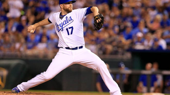 Kansas City Royals relief pitcher Wade Davis throws June 13, 2016, against the Cleveland Indians at Kauffman Stadium in Kansas City, Mo. Davis is returning to the Kansas City Royals, the team he helped pitch to the 2015 World Series title. Davis and the Royals agreed Wednesday to a minor-league contract, and the 35-year-old right-hander will go to spring training trying to earn a spot on the major-league roster.