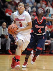 Marist guard Natalie Gomez-Martinez drives to the basket past Aaliyah Lewis of St. John's Monday night at McCann Arena in Poughkeepsie.
