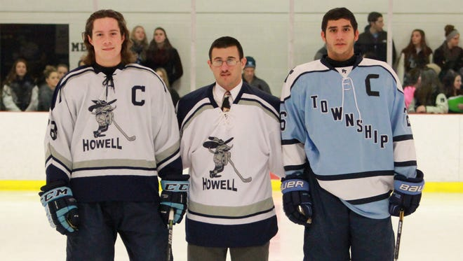 Kyle Hallbauer (left) and Greg Russo (right) pose with Brian Hodes prior to Friday night's game.