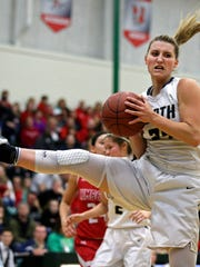 Sydney Levy of Appleton North pulls down a rebound