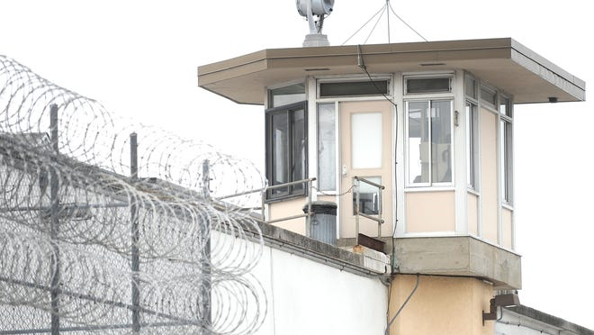 A corrections officer mans a guard tower at Waupun Correctional Institution. The state is proposing to eliminate 60 tower positions at prisons across the state in an effort to save $6 million.