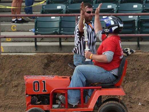 The action was fast and furious during the Demolition Derby at the Wisconsin Valley Fair in Wausau, Sunday, August 3, 2014. This gentleman won the lawnmower class as he was the sole entrant.