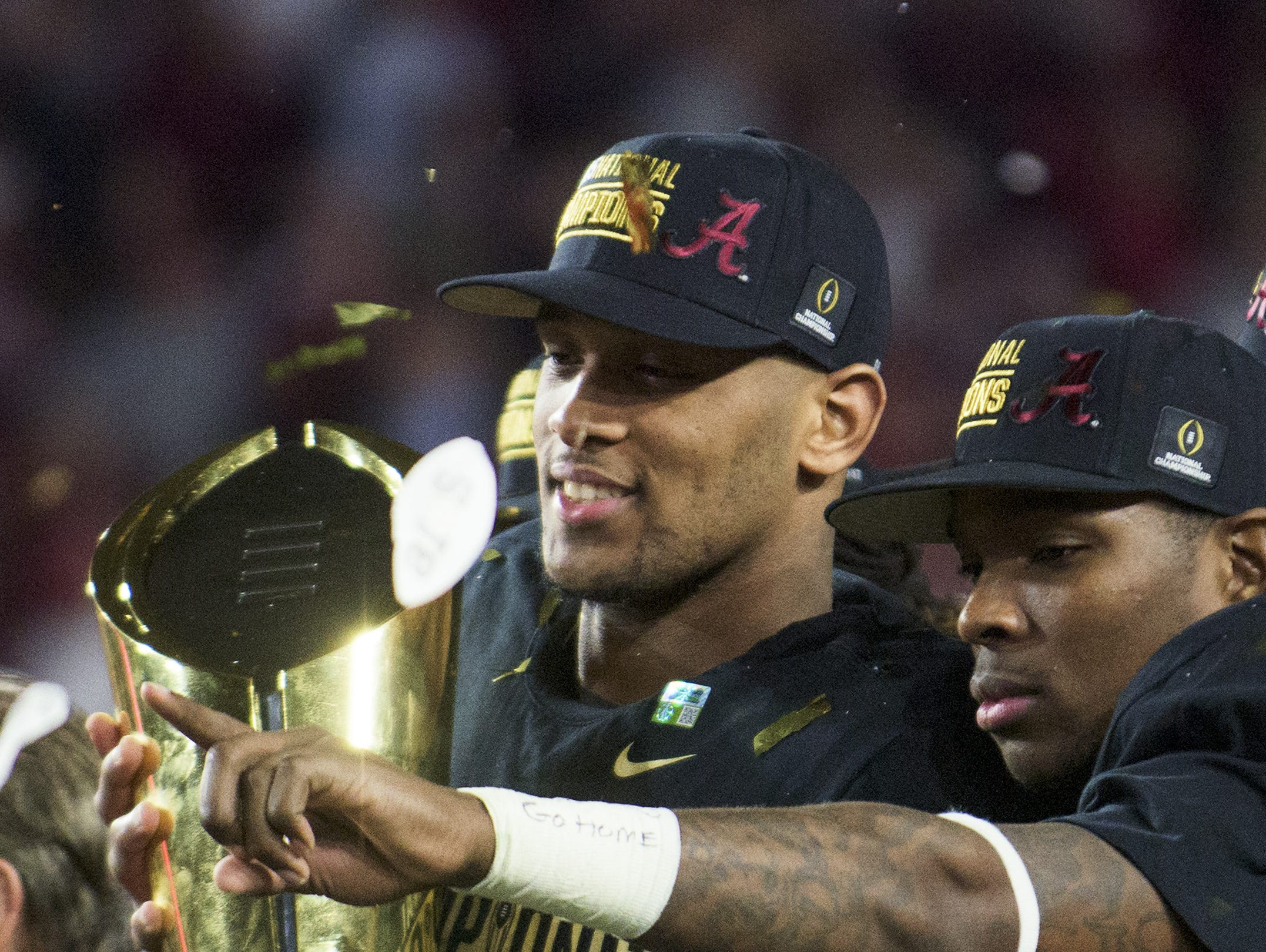 Alabama tight end O.J. Howard (88) and defensive back Eddie Jackson (4) celebrate with the championship trophy following the College Football Playoff Championship Game on Monday January 11, 2016 at University of Phoenix Stadium in Glendale, Az. (Mickey Welsh / Montgomery Advertiser)