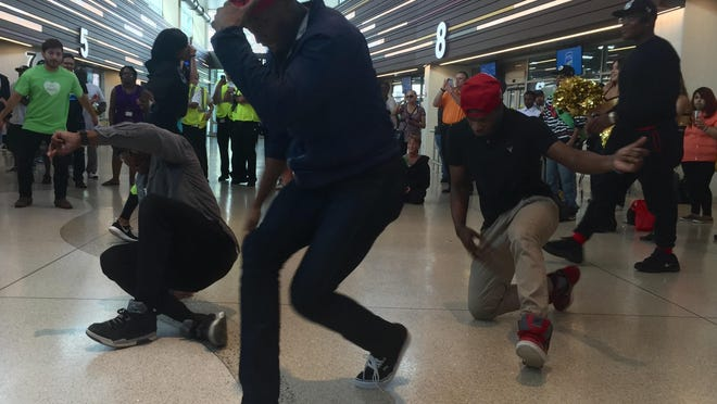 Dancers show off their moves during a flash mob at the Downtown Transit Center as part of ROC Transit Day.