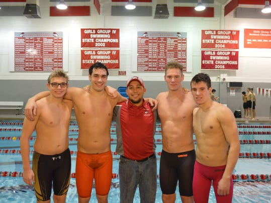 coach and swimmers.jpg