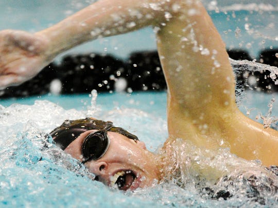 York Suburban's Erin Merkle swims her record-setting 500 IM Thursday vs. Dallastown. The Trojans girls won their portion of the meet while the Wildcats took the boys side. (Daily Record/Sunday News -- Kate Penn)