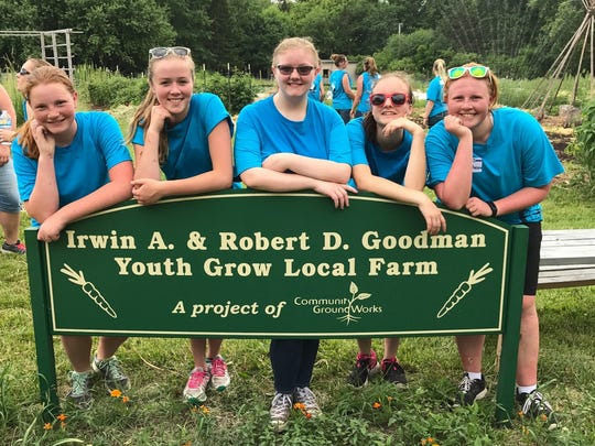 FFA members of the Flambeau Chapter take a break from working at Goodman Gardens, one of the Community Day of Service work sites in the greater Madison area.