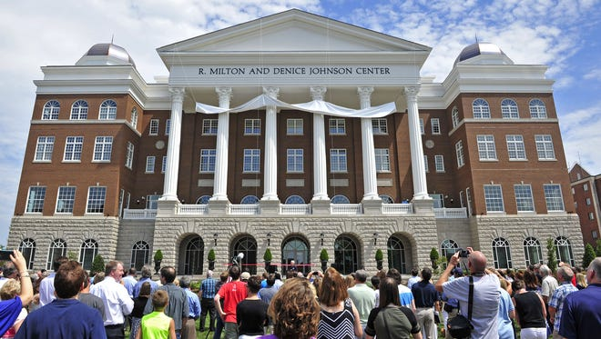 A name of the new building is unveiled on the Belmont University campus in Nashville, Tenn., Saturday, Aug. 22, 2015. The R. Milton and Denice Johnson Center is the new home for the Curb College of Entertainment and Music Business.
