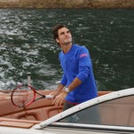 "Roger Federer plays ""speedboat tennis"" on Sydney Harbour with Lleyton Hewitt on January 12, 2015 in Sydney, Australia."