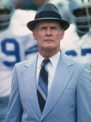 Dallas Cowboys head coach Tom Landry looks on during