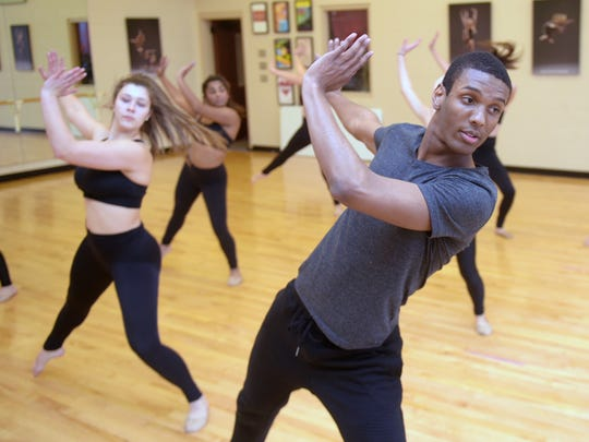 Brentwood Academy senior Tyler McNair is the school's first male member of the dance team and the team won a state championship earlier this year. McNair practices with the dance team during school Jan. 3, 2017.