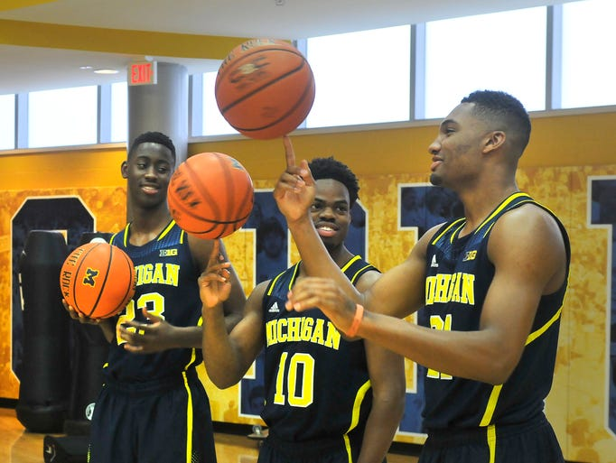 Michigan basketball players, from left, Caris Levert,