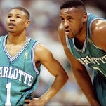 25 Feb 1997:  Charlotte Hornets guard Tyrone Bogues (left) and forward Rafael Addison look on during a game against the Dallas Mavericks at the Reunion Arena in Dallas, Texas.  The Mavericks won the game, 86-84. Mandatory Credit: Stephen Dunn  /Allsport