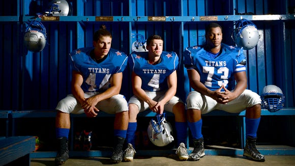 McDowell lineman Ishman Martino, left, wide receiver Tyler Banks, center, and offensive lineman Isaiah Burch are returning seniors for the Titans.