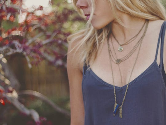 Ashley Dilger modeling her necklace.