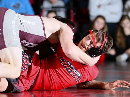 Phillipsburg's Cullen Day and Hunterdon Central's Colton Washleski wrestle in the 113 pound weight class bout at Hunterdon Central on Jan. 10, 2018.