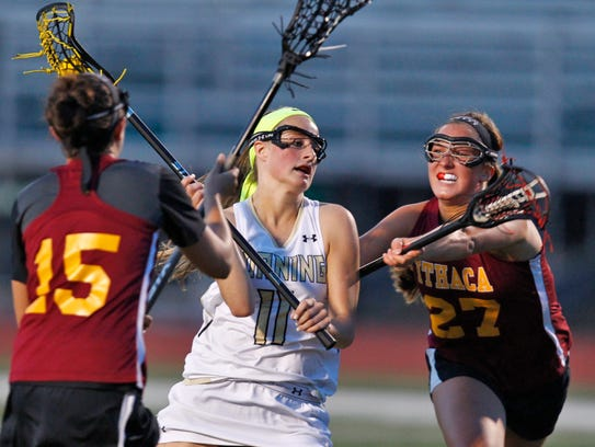 Corning's Lauren Ford gets double-teamed by Ithaca's