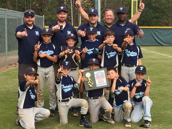 The Carolina Travelers 9 and under baseball team and its coaches.