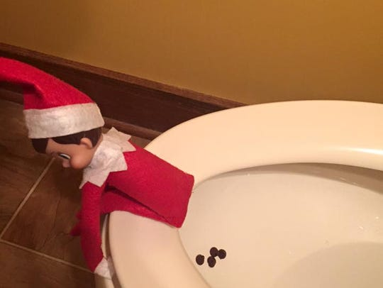 Elf on the Shelf pooping on the toilet.