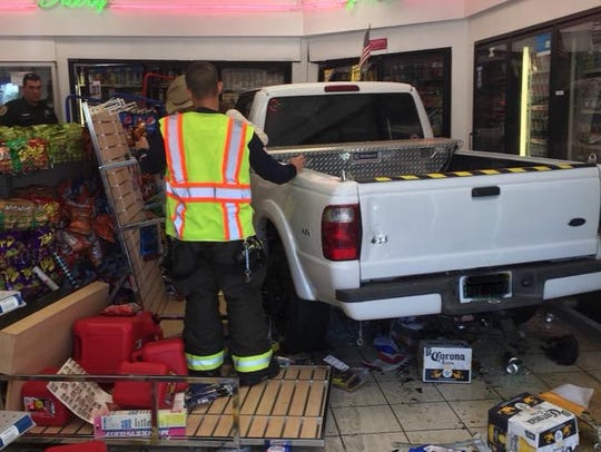 A truck drove through the front window of a Mobil gas