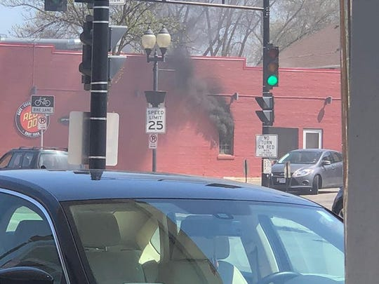 Smoke billows out of Red Dot in Wauwatosa on Monday, May 7.
