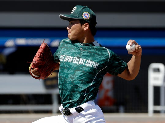 JR East Japan pitcher Yujiro Yamaguchi pitches to the Major League Baseball free agent during an exhibition game Thursday, March 1, 2018, in Bradenton, Fla. (AP Photo/Chris O'Meara)